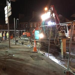 Roadworks underway at night at the junction of Temple Street and Connolly Street