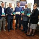 At the launch of the card at the Sligo County Museum were (left to right): Sam Moore, IT Sligo Archaeology Department (Organiser of Cromlechs, Crannógs and Cures, the W.G. Wood-Martin conference), Councillor Cathaoirleach Seamus Kilgannon, Richard Wood-Martin, great grandson of author Colonel William Gregory Wood-Martin (1847-1917), County Librarian Donal Tinney and Museum Attendant Ms. Angela McGurrin