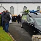 The coffin carrying the remains of Alex McGourty is carried by his father and family members from St Patrick's Church, Calry to the awaiting hearse following the funeral Mass last Tuesday