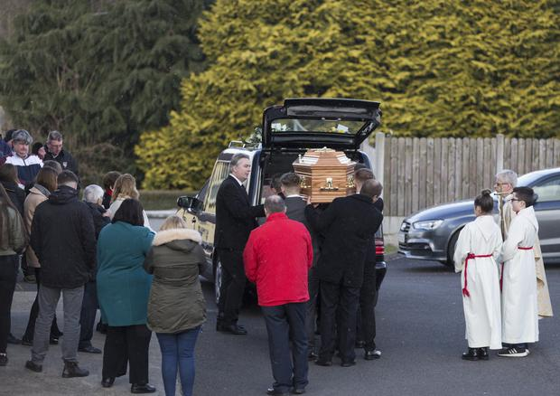 Fr Vincent Connaughton and mourners await the arrival of Jimmy Loughlin's remains at St Theresa's Church, Ballintogher