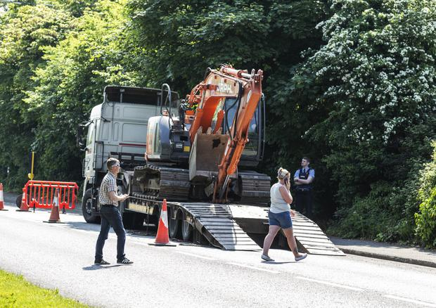 The scene at Ash Lane last Tuesday as an attempt was made to bring machinery on to the Glenview halting site.