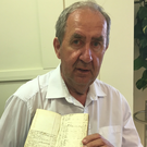Taunagh Bicentenary Celebration organiser John Taylor holds a church record from 1818