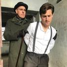 Actors James Glynn and Craig de Faoite playing the arresting detective and Michael Collins as part of a special performance at Sligo Gaol on Sunday
