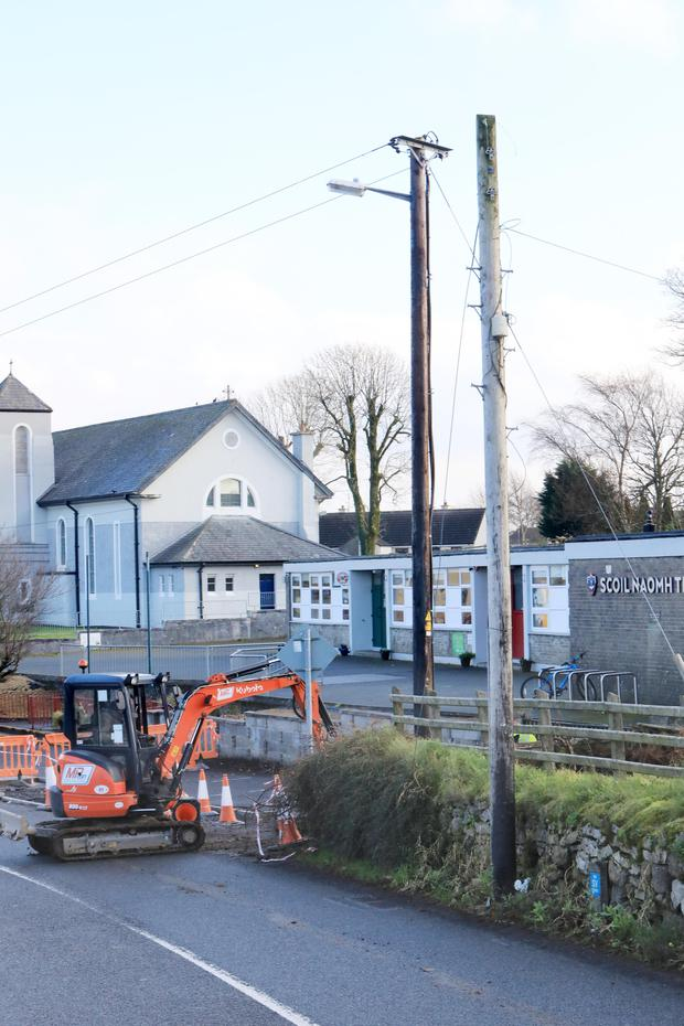 Work underway near the two poles outside the school at Ballintogher