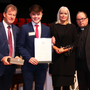 Emmett Harrison receives his scholarship award in the presence of JP McManus, Minister Mary Mitchell O'Connor and Fr Gerard Cryan, Summerhill College