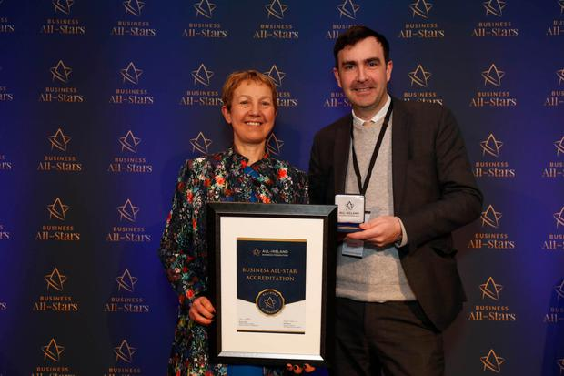 Hugh Arnold of Vendor Finance receiving All-Ireland Business Foundation All-Star accreditation at Croke Park from Dr Briga Hynes of the Kemmy Business School at the University of Limerick