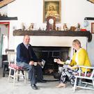 Nuala Mullaney meeting Pat Ward for tea at the early 20th century replicate Irish cottage Pat has completed at the Fox's Den, Keash