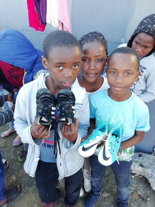 Boots were handed out to these children in Phillipi Informal Settlement.
