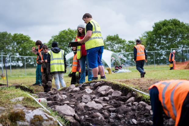 IT Sligo Archaeology students Jazmin Scally Koulak and Eugene Anderson sieving the soil at Carrowmore excavation