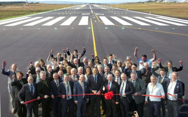 Pictured cutting the ribbon at the official opening of the newly resurfaced runway at Ireland West Airport were An Taoiseach, Leo Varadkar, flanked by TD and Minister for Rural and Community Development, Michael Ring, TD and Arthur French, Chairman, Ireland West Airport