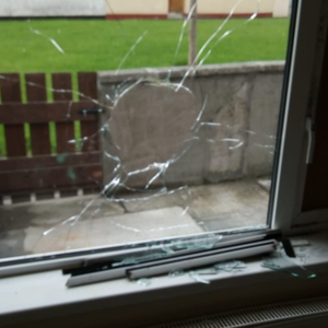 A smashed downstairs window