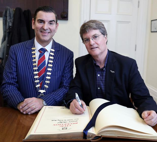 Dacre Stoker signs the visitors book at City Hall last Wednesday, accompanied by Cathaoirleach Councillor Tom MacSharry
