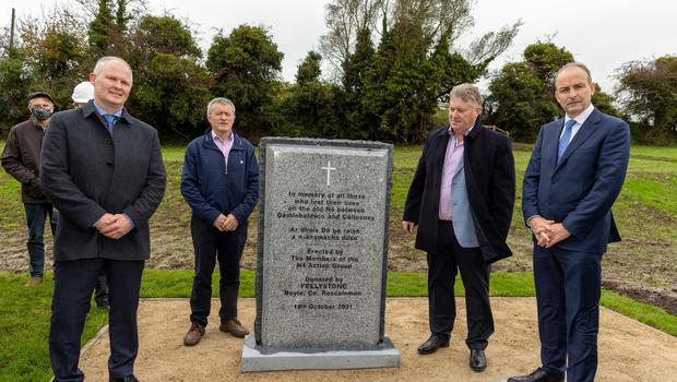 Members of the N4 Action Group, Bernard Mulhern, Andrew Hannon and Liam Brennan with An Taoiseach Micheál Martin pictured at a memorial beside the new dual carriageway to mark all the lives lost on the old N4 between Collooney and Castlebaldwin.