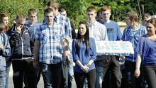 Friends of Shane all wear blue – his favourite colour – for the funeral of the Skeffington brothers.