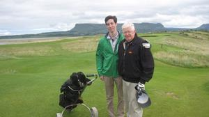 The late Charles H McCabe Jr playing County Sligo Golf Club, Rosses Point with grandson, Brian.