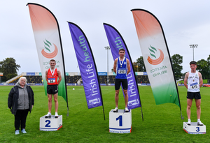 Athletics Ireland President Georgina Drumm, left, with Junior Men's 1500m medallists, Tadgh Donnelly of Drogheda and District AC, Louth, silver, Sean Donoghue of Celtic DCH AC, Dublin, gold, and Michael Morgan of Sligo AC, bronze. Pic: Sam Barnes/Sportsfile