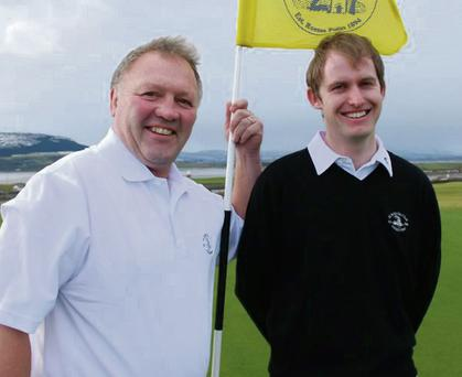 Professionals Jim Robinson and Keith O'Neill show off the new black and white colours for Co Sligo Golf Club's men's teams.