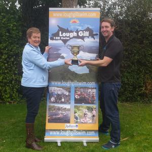 Mary Kelly and Paul McGarry hold the Lough Gill Cup.