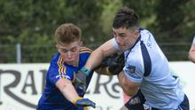 Daniel Rolston of Easkey in action with St John's Enda Roche in Seamie Donegan Park on Sunday. Pic: Donal Hackett