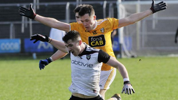 Sligo captain Paddy O'Connor is challenged by Antrim's Niall Delargy in Markievicz Park on Sunday. Pics: Carl Brennan