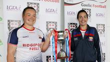 Eoghan Rua joint captains Joanne McDonnell and Orna O'Dowd celebrate with the trophy. Pics: Carl Brennan