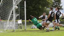 Gary Gaughan of Tourlestrane in action with Coolaney/Mullinabreena's Nathan Rooney on Saturday. Pic: Carl Brennan