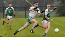 Robbie Ryan of St Molaise Gaels in action with Curry's Red Óg Murphy in Connolly Park on Saturday. Pic: Carl Brennan