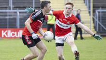 Ciaran McLoughlin of Drumcliffe/Rosses Point in action with Coolera/Strandhill's Kevin Banks in the Homeland SFC semi final. Pic: Donal Hackett