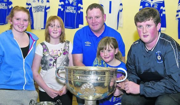 Saoirse Finan, Eire Finan and Berenie and Alana Finan and Cathal Finan with the Sam Maguire Cup at Coolaney/Mullinabreena GAA club