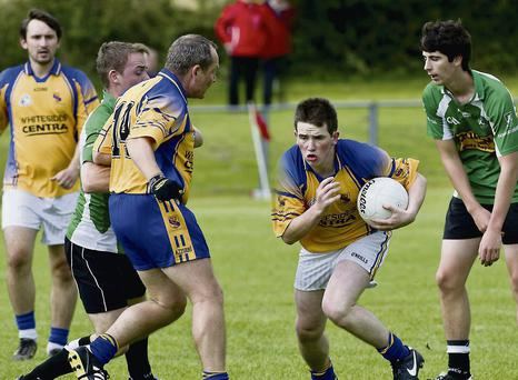 Garrett Lavin of Owenmore Gaels wins possession against St. Michael's at Corran Park on Sunday. (Pic by Tom Callanan)