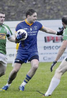 Barry O'Boyle, Carly/St Joseph's takes on St. Michael's players during their clash. (Pic: Carl Brennan)