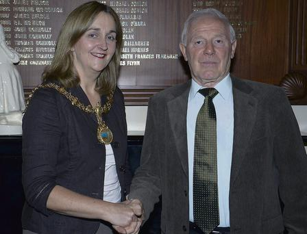 Legendary Sligo handballer, Paddy Walsh, is congratulated by the Mayor of Sligo, Clr. Marcella McGarry, at a Civic Reception held in his honour at Sligo City Hall.