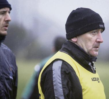 Sligo manager, Pat Flanagan, watching the drama unfold as his side played GMIT at Connolly Park, Collooney,
