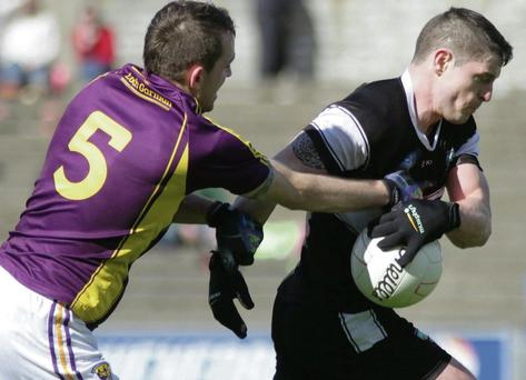 Brian Curran, Sligo holds onto possession during their Allianz Football League Div. 3 match against Wexford in Wexford Park on Sunday.