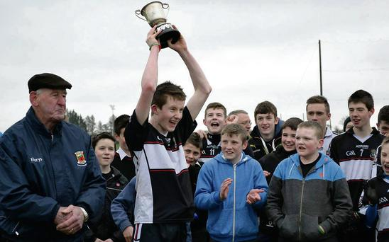 St. Attracta's captain, Colm Doddy, celebrates with the Connacht Championship trophy