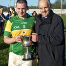 Peter Molloy presents the Dermot Molloy Cup to Padraic McVeigh of Tourlestrane, after they defeated Calry/St Joseph's in the Final at Tourlestrane last Sunday