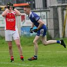 Cian Barrins of Castleconnor shows his dismay as Geevagh's Jodie O'Reilly scores his side's second goal
