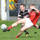 Dean Maguire drives the ball up the right wing for Louth as Sligo's Mark Breheny challenges. Pic: Ken Finegan