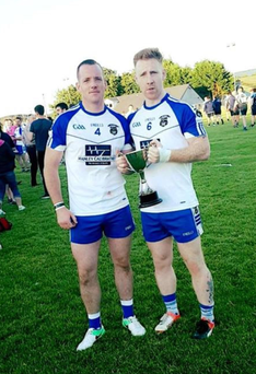Dominic Kearns and Daithí O'Reilly of Geevagh celebrate with the Benson Cup after defeating St John's 0-12 to 0-9 in the final