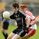 Roland Anderson of Sligo in action against Fergal Mortimer of Derry during the Electric Ireland All-Ireland GAA Football Minor Championship Quarter-Final match between Derry and Sligo at Mac Cumhaill Park in Ballybofey. Photo by Oliver McVeigh/Sportsfile