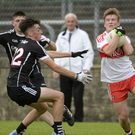 Richie Mullan of Derry in action against Ciaran O'Dowd of Sligo during the All-Ireland Quarter Final