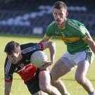 Coolera/Strandhill's Killian McCahey in action with Cathal Burns of St Molaise Gaels. Pic: D Hackett