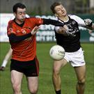 Mark McGoldrick of St Mary's and Eoin Coleman, Tubbercurry contest for the ball. Pic: Tom Callanan