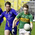 Liam Gaughan of Tourlestrane evades the challenge of Calry/St Joseph's Barry O'Boyle. Pic:Tom Callanan