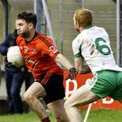 Stephen Coen of St Mary's in possession as Ross Donovan, Eastern Harps defends. Pic: Tom Callanan