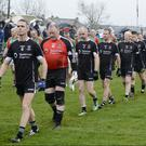 Sligo captain David Durkin leads the team in the parade before throw-in. Pic: Tom Callanan