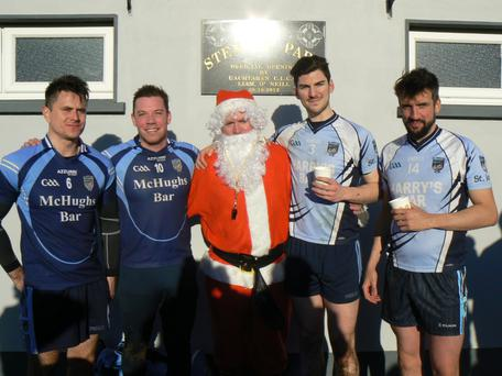 After the Exiles v Home team Gaelic Football match at Stenson Park on St. Stephen's Day are: Patrick Greene (New York), Brian Harris (London), Referee, Santa Charlie Jordan with home based players James Murphy and Shane Stenson