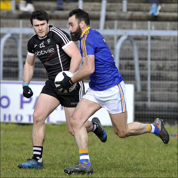 Pat Hughes of Sligo in action with Longford's Diarmuid Masterson in their Allianz Division 3 Rd 5 match in Markievicz Park on Sunday. Pics: Tom Callanan