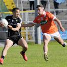 Sligo captain Kevin McDonnell in possession with Armagh's Connaire Mackin in Markievicz Park. Pics: Carl Brennan