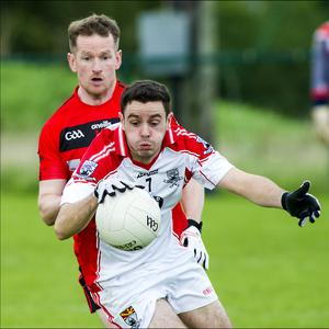 Aaron O'Boyle of Coolera/Strandhill in action with St Mary's Mark Breheny in Connolly Park on Sunday in the Belfry Senior Football Championship quarter final. Pic: Tom Callanan